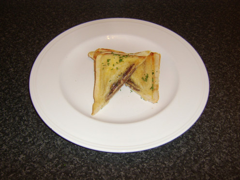 Toasted sandwich filled with a Scottish Lorne sausage, cheddar cheese and chives