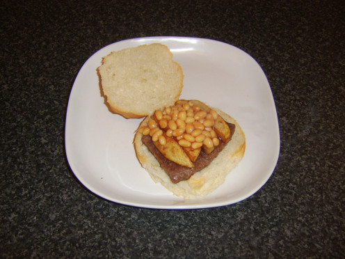 A Lorne (sliced) sausage, homemade chips and beans are served on a bread roll
