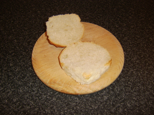 Bread roll is halved for assembling sandwich