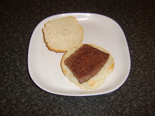 Sausage is laid first on bread roll