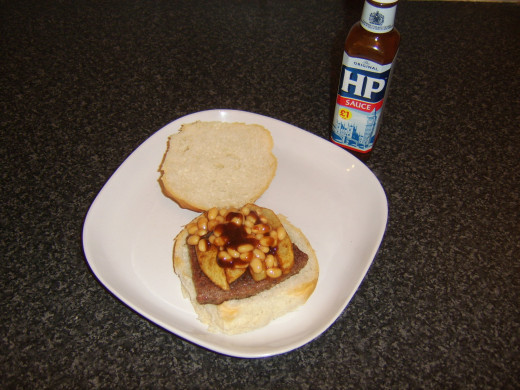 HP Sauce is an optional but tasty addition to a sausage, chips and beans sandwich