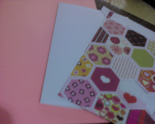 assorted gift wrappers and pink color construction paper