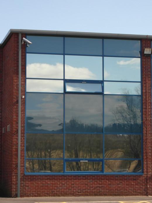 Windows reflecting sky