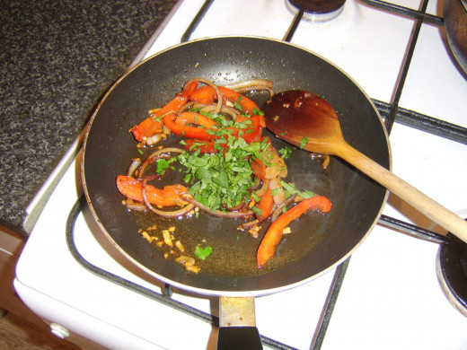 Parsley is added to stir fried vegetables