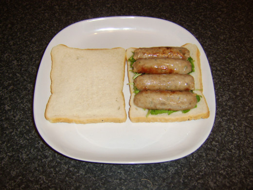 Sausages laid on watercress