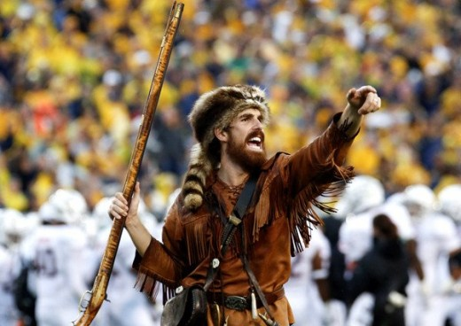 The West Virginia University mascot, The Mountaineer during a football game.
