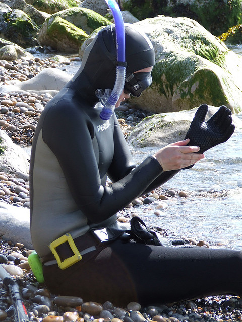 Gearing up to go for a dive and spear fish