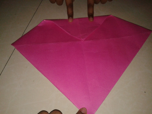 Flip over and fold one corner to the center