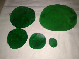 green circular papers each of 1cm diameter difference
