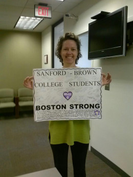 Our completed Sanford Brown College poster before it was taken to the memorial site. Pictured is Laura Bonetzky-Joseph on campus
