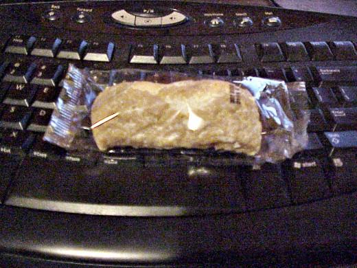 "One ""Dunkin Stick"" computing away on the ""eat 'em"" keys"