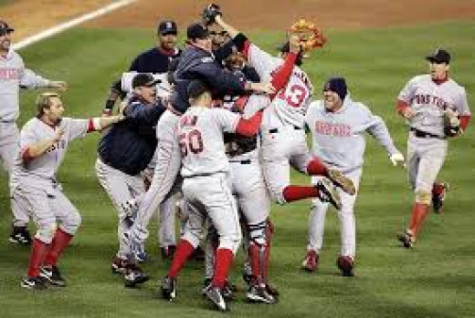 The Red Sox celebrate an ALCS series victory after an unlikely 4-3 series win after being down 0-3 to their hated rivals, the Yankees in 2004.
