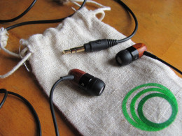 Detail of ThinkSound TS02 earbuds with included cloth case
