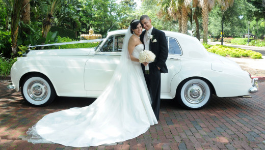 Bride and Groom With White Rolls Royce