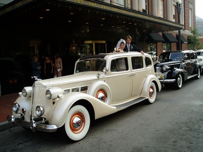Bride and Groom With Antique Wedding Car