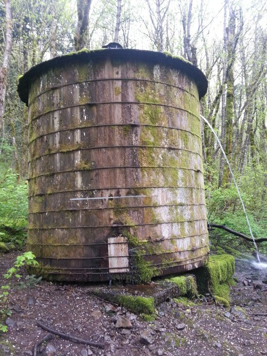 An old water tower greets us on our path.