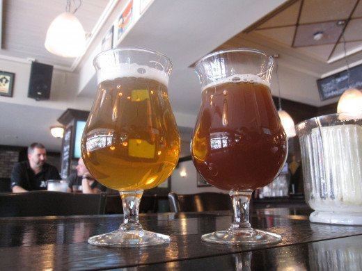This photo demonstrates the range of appearances in the IPA style.  On the left is a yellow, filtered IPA while the right is unfiltered and far darker and orange.  IPAs can fall on any part of this spectrum between these characteristics.