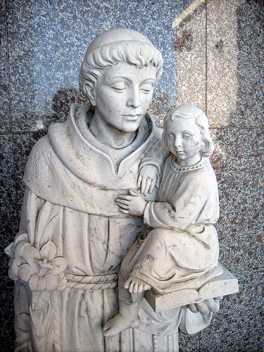 Saint Anthony depicted holding Jesus.