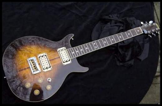 Bob Marley's Custom made Washburn 22 series Hawk