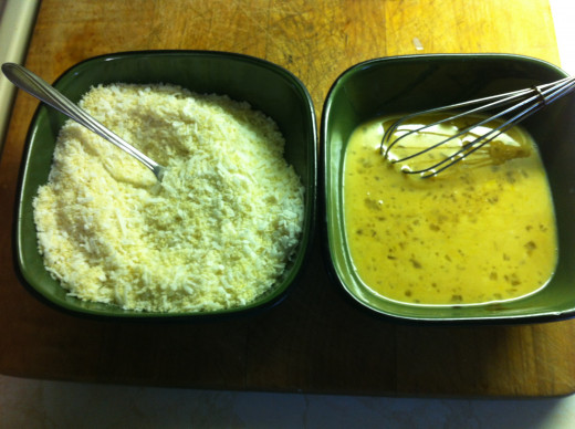 On the left is coconut mixed with almond flour, and in the right bowl eggs whisked with milk and hoisin sauce
