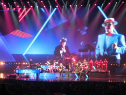 Elton playing along while gigantic photos of himself are projected in the background... this show features fascinating special effects!