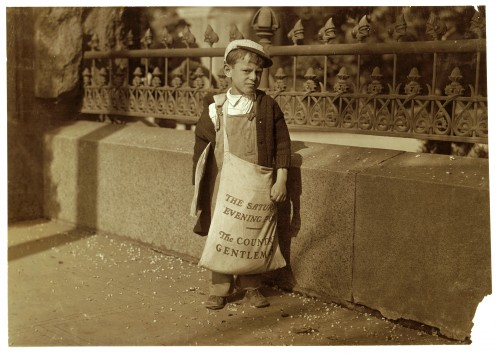 Freddie Kafer, selling Saturday Evening Posts and newspapers at the entrance to the State Capitol. Age 5 or 6, he did not know his age, nor much of anything else (1915).
