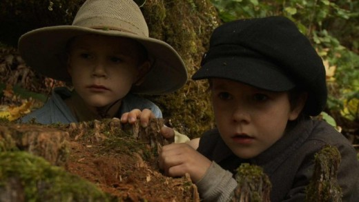 Henry and Sam take cover behind a fallen tree.