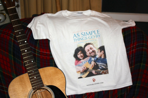 "This is a T-shirt showing the cover to my third book in a trilogy, ""As Simple Things Go By""."