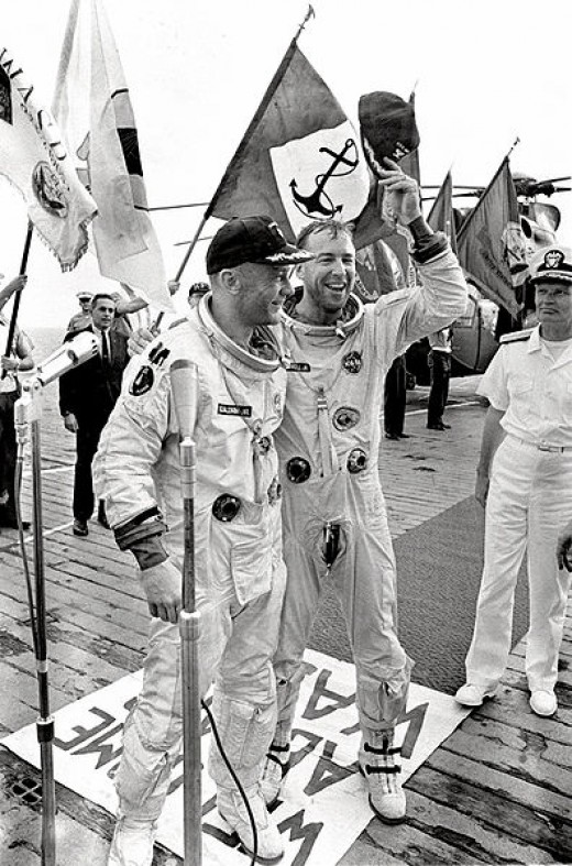 Astronauts  Edwin E. Aldrin Jr. and James A. Lovell (now with Golden Spike) on the aircraft carrier USS Wasp after their Gemini 12 splashdown.