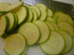 Zucchini slices being readied for use in this recipe.