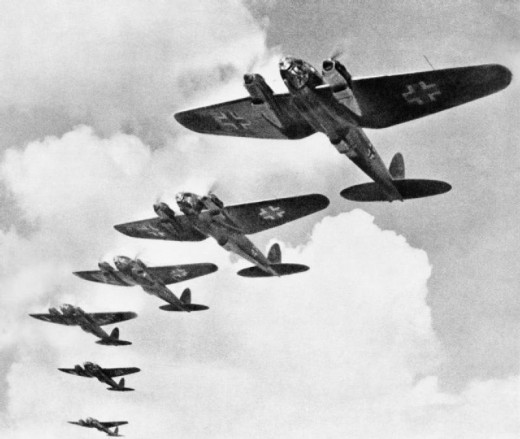 These early Heinkel planes flying in formation are showing the Luftwaffe cross.