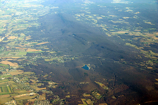 This oblique aerial photo (looking north) shows the long ridge of South Mountain. The AT follows the ridge for a long way through Maryland.  I-70 can be seen bisecting the ridge. Also rock outcroppings along South Mountain are evident.