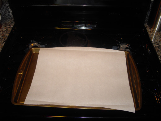Line a baking sheet with parchment paper. This way, there's no need to oil the pan, and the tots don't stick at all!