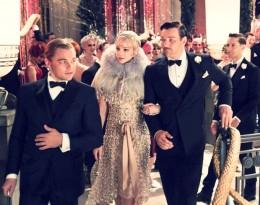 Gatsby (Leonardo DiCaprio) shows Daisy and Tom Buchanen (Carey Mulligan and Joel Edgerton) around his home as Nick Carraway (Tobey McGuire) looks on.