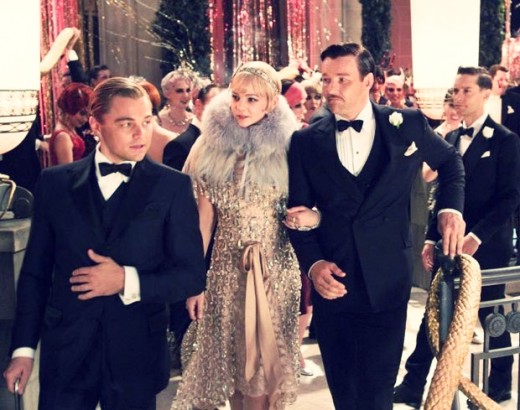 Gatsby (Leonardo DiCaprio) shows Daisy and Tom Buchanen (Carey Mulligan and Joel Edgerton) around his home as Nick Carraway (Tobey McGuire) looks on.