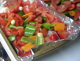 Try to keep everything at an even level. Place smaller slices of pepper on top of everything.