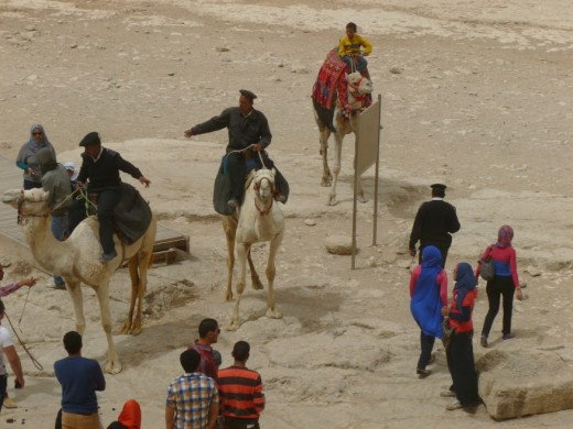 Tourist police on camels at the Pyramids Copyright RE Kongaika