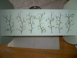 3. Add tendrils and leaves to the basic vine design.