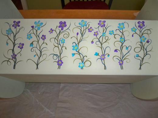 7.  Use white and/or pale colors to add flower centers and highlight the petals.