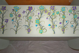 8. Use a pop of color to outline the flowers and highlight the vining designs with dots.