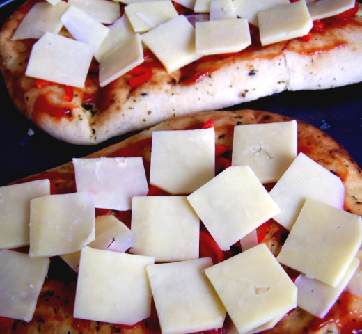 Quick & Easy Pizza Recipe: Add the cheese topping.