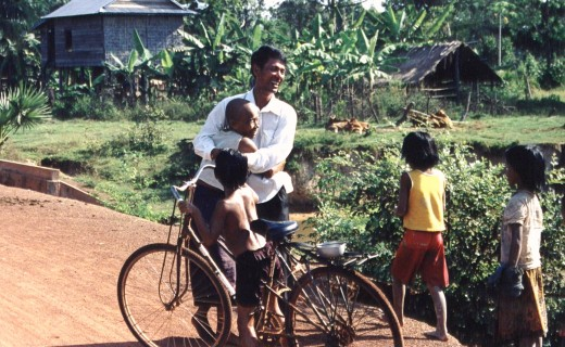 Family is reunited in Cambodia after 27 years or more? This picture is of my driver...I asked him to stop at a lotus pond in a small village and witnessed a reunion that still gives me goosebumps. This is his aunt who ran up to him...