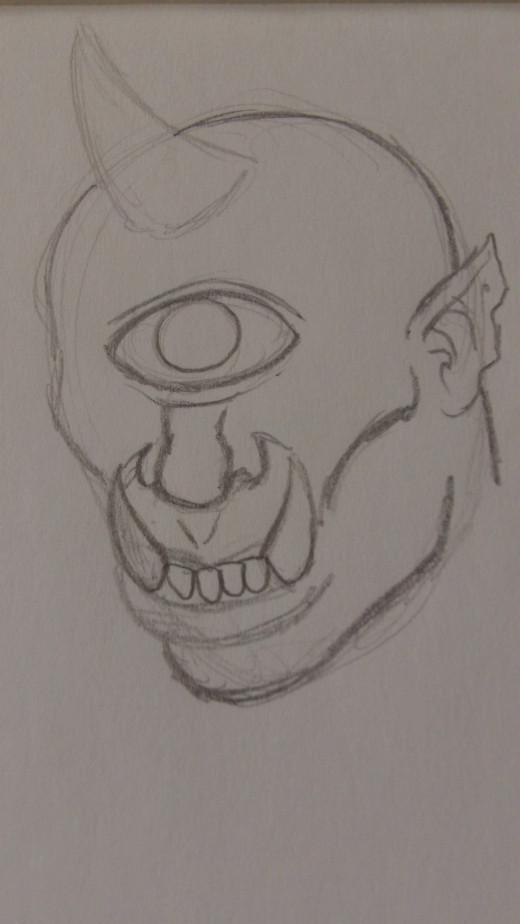 Then darken the jawline, cheek bone and draw the ear