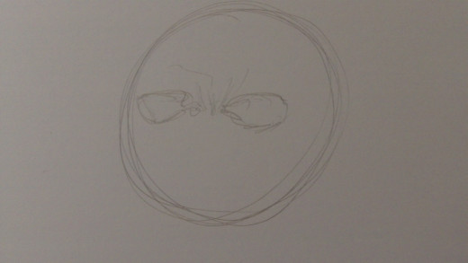 Draw in some eye sockets with rough frown lines in between the eye sockets