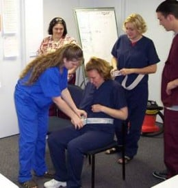 Here we have a group of nursing students training to become certified nursing assistants.
