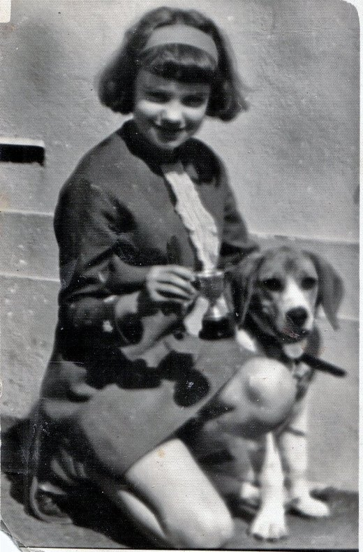 A treasured photo of myself and my precious Lassie taken by a kindly neighbour after I won  a silver cup in school for a story entitiled 'Kindness To Animals.'