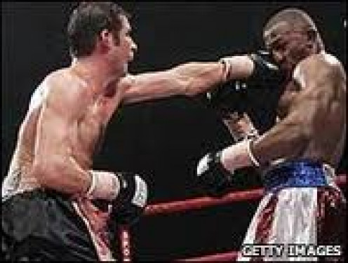 Joe Calzaghe unified the Super Middleweight division by beating Jeff Lacy by lopsided decision.