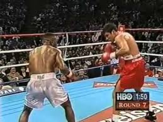 An aging Pernell Whitaker loses a close, controversial decision to Oscar De La Hoya.
