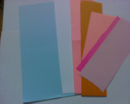 some assorted colorful construction papers