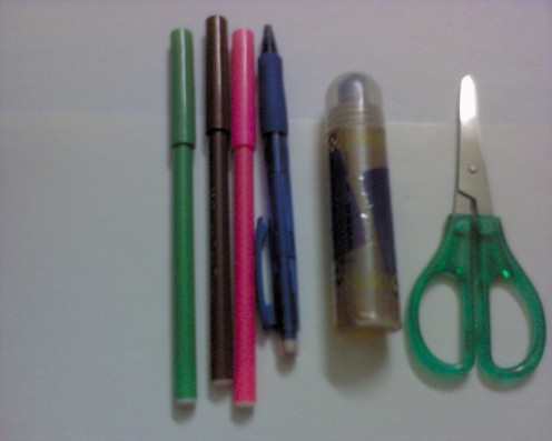 Basic stationary items: colorful markers, pencil, glue, scissors
